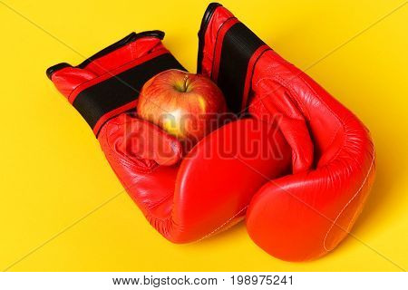 Sport Equipment And Fruit Isolated On Striking Yellow Background