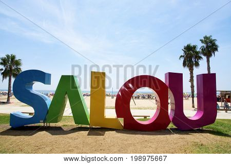 SALOU, SPAIN - AUGUST 3, 2017: A big Salou sign at the Llevant Beach in Salou, Spain. Salou is a major destination for sun and beach for European tourism with more than 50,000 accommodations