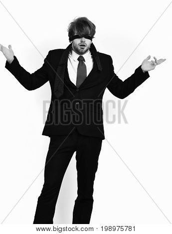 Bearded man short beard. Caucasian stylish surprised macho with moustache in elegant suit red tie white shirt with blindfold eyes posing at studio isolated on white background