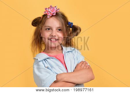 Kid With Cute Pink Bow On Head And Messy Hair