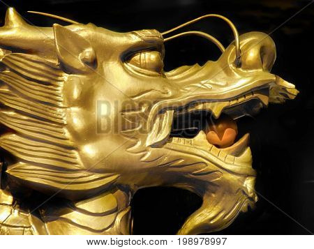 A golden dragon outside a temple in southern Korea.