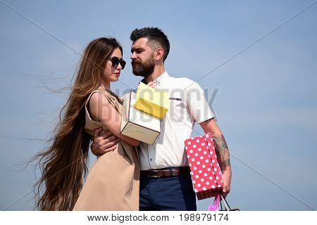 Couple Carries Packets And Polka Dotted Box On Blue Background