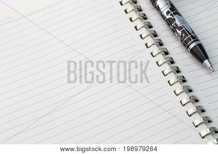 World map pen with North America and South America on blank note pad with space for text - close up view