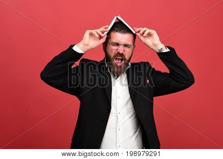 Businessman With Disgusted Face And Glasses On Light Red Background