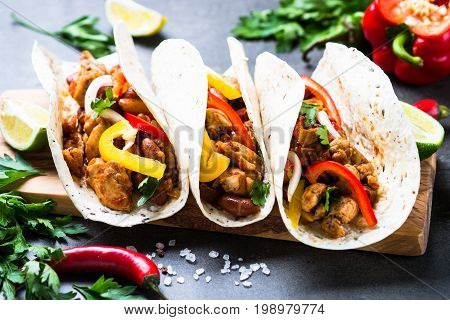 Mexican taco with meat beans and vegetables. Latin american food.