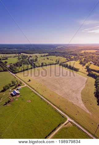 Midwestern farm with cut hay and finished hay bales