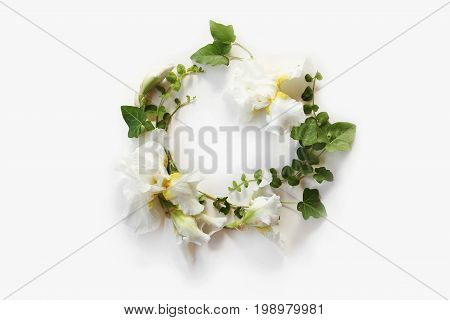 Floral Round Crown (wreath) With Iris White Flowers, Buds And Green Ivy Branches On White. Flat Lay,