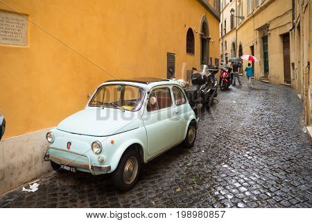 ROME ITALY - OCTOBER 18 2016: small vintage fiat 500 parked in the city center