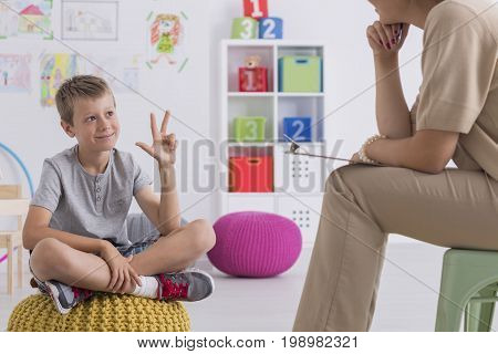 Boy Enumerating Something During Therapy