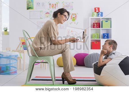 Therapist Showing Drawing To Boy