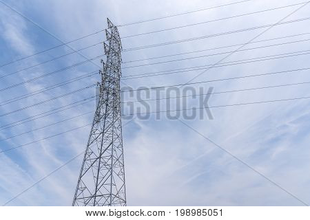 Wire Electric Telecom post and cable wth blue sky background