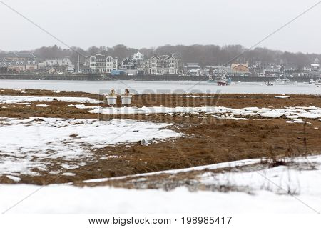 Scituate Massachusetts USA - January 7 2009: A first glance suggests a couple is relaxing in adjoining bathtubs on a cold winter day along the Scituate waterfront