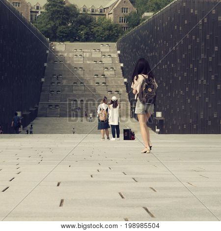 Seoul - July 2017: Student walking in campus complex at Ewha Womans University.