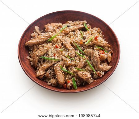 Asian food bowl isolated at white background. Teriyaki beef with rice, mushrooms, sesame and lemon grass. Japanese restaurant food delivery