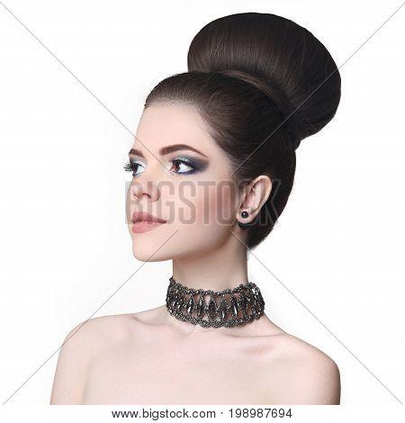 Beauty Makeup Girl. Fashion Bun Hairstyle. Attractive Teen Brune