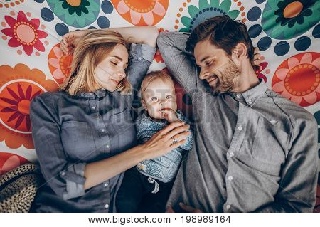 Cute Family Resting On Boho Hammock With Smiling Baby Boy, Young Hipster Family On Camping Trip Lyin