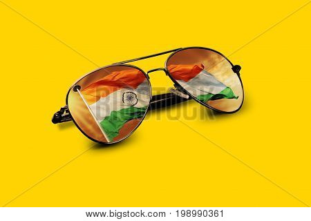 Indian Flag Reflected on Aviator Sunglass on yellow background