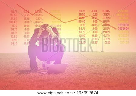 Asian businessman failing and serious ,Businessman fired from job sitting sad outside office on blurred technical stock market background, Soft focus