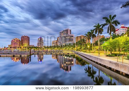 West Palm Beach, Florida, USA downtown skyline on the waterway.