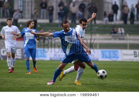 KAPOSVAR, HUNGARY - APRIL 16: Daniane Jawad (in white R) in action at a Hungarian National Championship soccer game - Kaposvar vs MTK Budapest on April 16, 2011 in Kaposvar, Hungary.