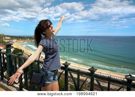 The beautiful girl on holidays in a Spain Balcony of Mediterranean Tarragona Costa Daurada Catalonia