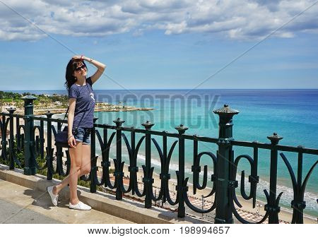 Beautiful Girl On  Holidays In A Spain, Balcony Of Mediterranean, Tarragona, Costa Daurada, Cataloni
