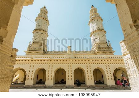 SRIRANGAPATNA, INDIA - FEB 18, 2017: High structures of white minarets of historical Jama Masjid with arches and courtyard on February 18, 2017. Tippu Sultan built this masjid in 1784