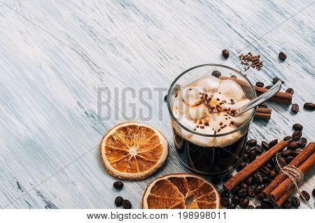 Background with hot chocolate and marshmallows.Cinnamon and dried orange