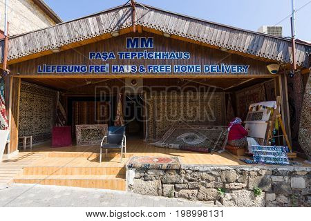 SIDE TURKEY - JULY 07 2015: Shops on sale of carpets. Anatolian coast - a popular holiday destination in summer of European citizens.