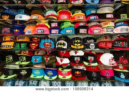 SIDE TURKEY - JULY 07 2015: Baseball caps with different brand names. Shop on the waterfront. Anatolian coast - a popular holiday destination in summer of European citizens.