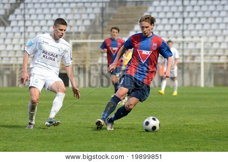 KAPOSVAR, HUNGARY - APRIL 20: Attila Polonkai (R) in action at a Hungarian National Cup soccer game Kaposvar vs Videoton April 20, 2011 in Kaposvar, Hungary.