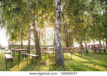Beer garden in the sunshine under the trees