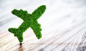Green aircraft on wooden desk. 3D illustration.