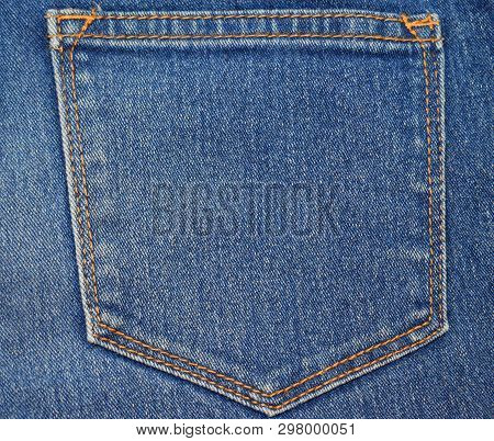 Stock Photo Part Of Jeans With A Back Pocket. Textured Background