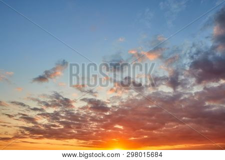 poster of Dramatic sunset cloudy sky with picturesque clouds lit by warm sunset sunlight, natural sunset sky landscape view,natural sunset sky background, colorful sunset sky with dramatic sky clouds lit by evening sunlight - sunset sky landscape