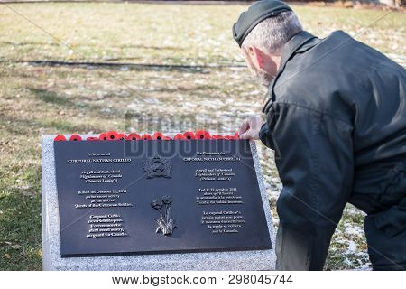 Ottawa, Canada - November 11, 2018: Soldier Putting Remembrance Poppy On The Plaque To Nathan Cirill