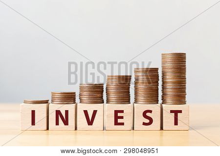poster of Money coins stack stair as step growing growth and wooden cube block with word INVEST. Investment and save money concept
