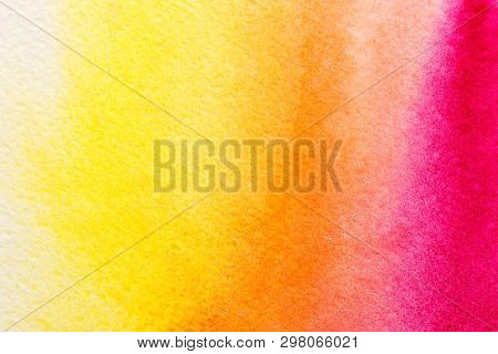 Hand Painted Abstract Watercolor Wash Background In Yellow, Orange And Red Colors On Rough Paper Tex