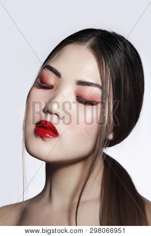 Portrait of young beautiful asian girl with long hair and red lipstick