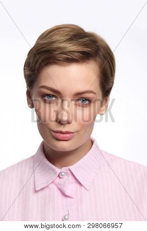 Vintage style portrait of young beautiful woman with clean make-up