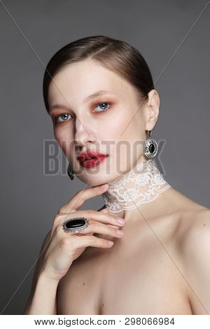 Vintage style portrait of young beautiful woman with red lipstick