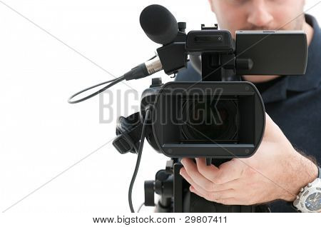 Video camera operator working with his professional equipment isolated on white background