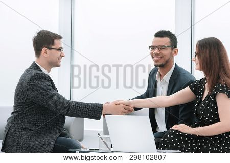 Handshake Of Business Partners After Discussing A New Joint Project.