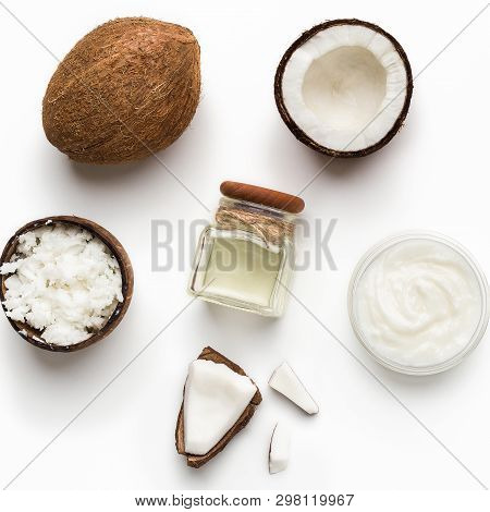 Fresh Chopped Coconuts, Coco Flesh And Jar Of Coconut Oil On White Background, Top View. Organic Coc