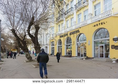 Feodosia, Crimea, Russia - March 08, 2019: People On The Avenue. Aivazovsky Near The Grand Cafe Deni