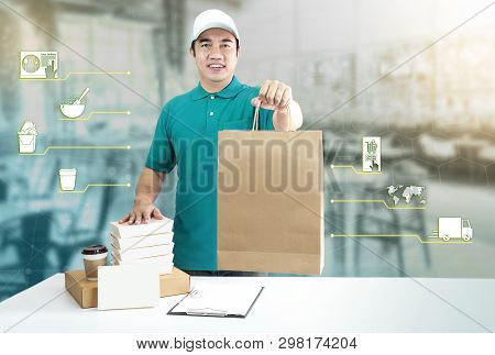 Food Delivery Service For Order Online And Icon Media. Delivery Man In Blue Uniform Hand Holding Pap