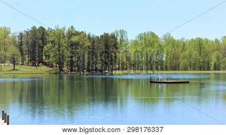 Trees Cast Deep Reflections In The Waters Of The Lake At Vastwood State Park In Hawesville, Kentucky