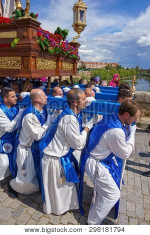 Merida, Spain. April 2019: A Group Of Bearers, Called Costaleros, Carrying A Religious Float