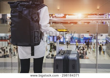 Young Woman Wearing Casual Clothes Is Posing At Airport, Traveler Woman Plan And Backpack See The Ai