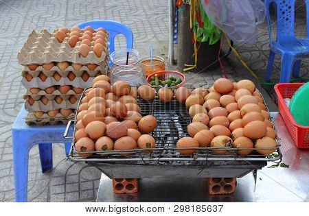 Cooking Eggs On Charcoal Bbq Grill For Sale In Street Market In Vietnam. Traditional Local Cuisine O